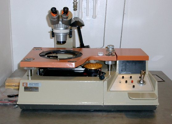 The automated probe station is used to test numerous detectors on a semiconductor wafer for operating characteristics.
