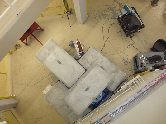 Top view of the neutron diffractometer. The system uses a pyrolytic graphite crystal to diffract neutrons at 0.0253 eV.
