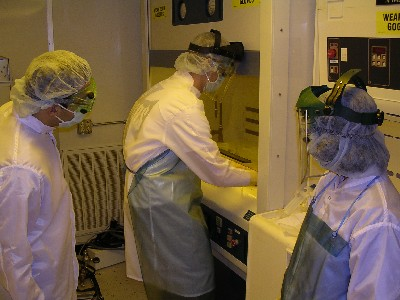 Students performing wet chemistry work in the class 1000 clean room.