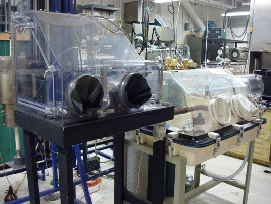 Glove boxes are used to prepare materials samples for crystal growth.