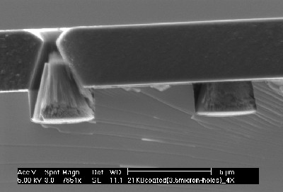 Films quite thick can be applied. Whereas before, cracking would occur with films of only 1 micron thick, shown is a well adhered film 4 microns thick.