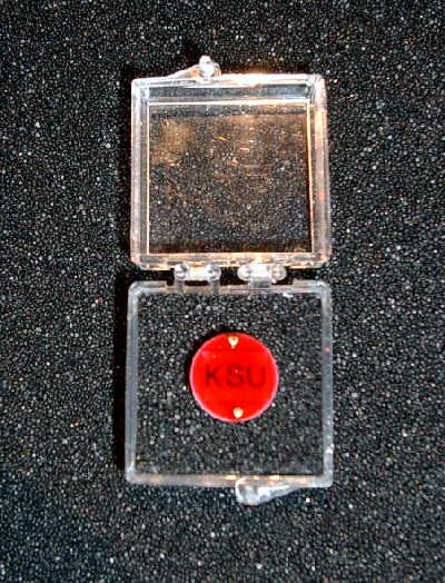 A closeup view of a coated-GaAs neutron detector designed, developed, and fabricated in the KSU SMART Laboratory. The detectors are coated with a proprietary encapsulate to prevent damage to the delicate devices and wire leads. As a result, the final device is robust and sturdy.