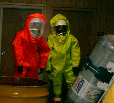 HAZMAT crew returning from investigating an unknown leaking drum.  They are wearing a completely sealed Level A suit.