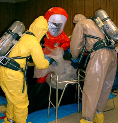 Special care must be taken to not spread any contamination.  The Level A suits are difficult to work in and require assistance when moving through decon.