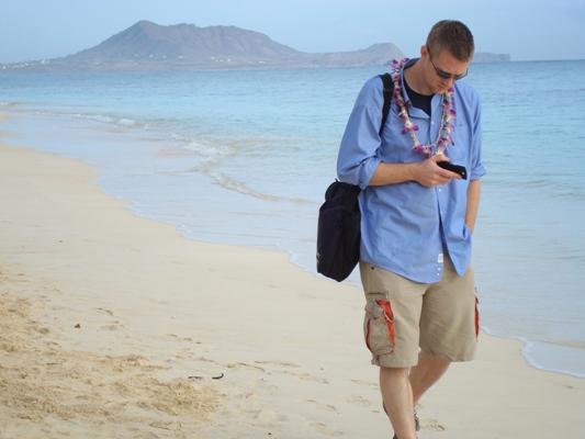 Mark Harrison walking the beach.