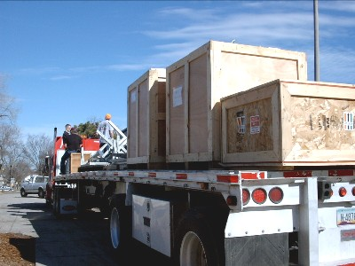 The flatbed truck was loaded from front to back with the furnaces, materials, and equipment.