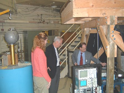 Katy Bors and Dr. Foulkes listen as Dr. McGregor explains a neutron detection experiment being conducted at a TRIGA reactor beamport.