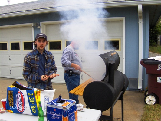 David Bruno and Jeff Blackwell work the barbeque pit.