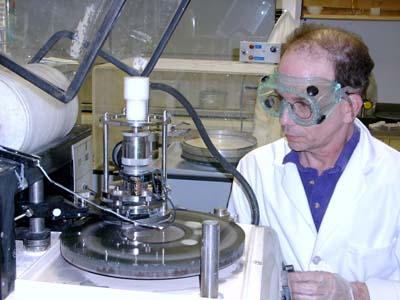 Dr. McGregor is polishing a GaAs wafer to be fabricated into numerous neutron detectors.