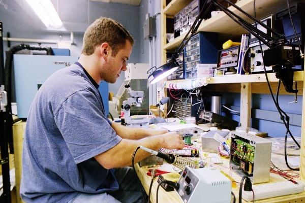 Jeff Sanders in working on the electronics for a semiconductor neutron imaging array (lower right).