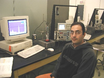Alireza Kargar demonstrates a gamma ray spectrometer for engineering open house.