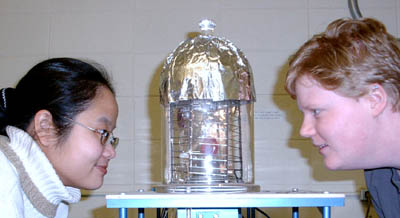 Elsa and Bridget inspect a large HgI2 crystal they have been growing using a vertical furnace.