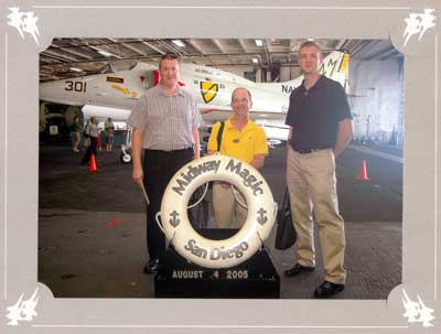 From left to right, Martin Ohmes, Dr. McGregor, and Mark Harrison visit the aircraft carrier Midway after attending the 2005 SPIE conference in San Diego.