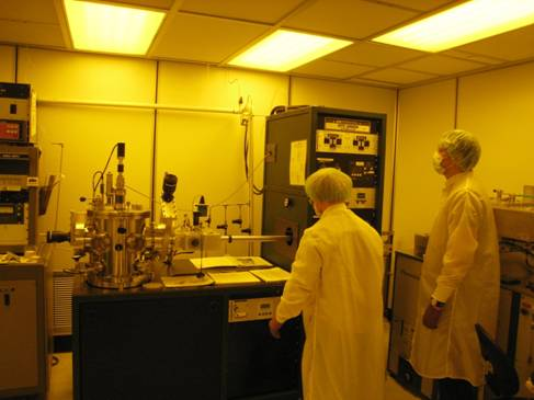 Students operate the RF/DC sputtering system in the vacuum process bay.