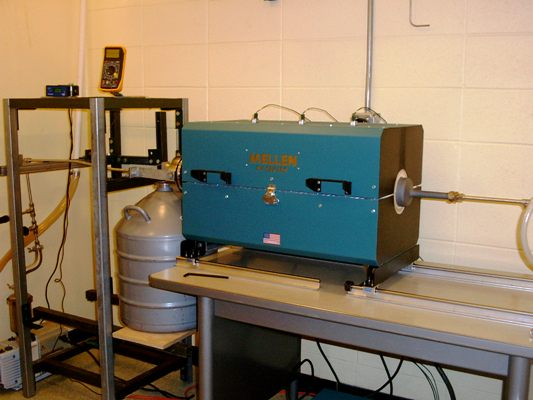 The low pressure condensation deposition system is used to backfill microscopic perforations with LiF.
